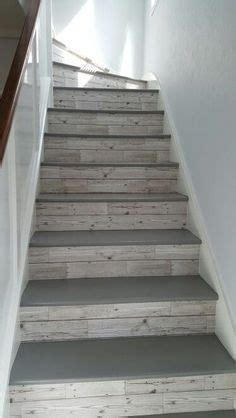 grey floor paint on the top of the steps and wood wall